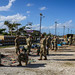 Soldiers and Airmen work together to build temporary roofing for residents in Saipan recovering from Super Typhoon Yutu