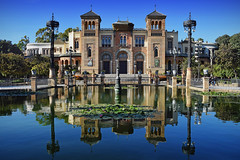 Pabellon Mudejar, Maria Luisa Park (Jocelyn777) Tags: water reflections waterreflections buildings architecture mudejar seville andalucia spain travel sky blue