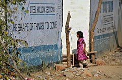 Shape of Things to Come (Pedestrian Photographer) Tags: girl shape things come sign walls alley between buildings india pushkar indian pink