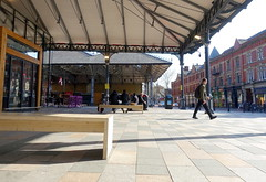 Under used space in front of Preston Market (Tony Worrall) Tags: architecture urban building built sunlit prestonmarket market new redevelopment stone cool seat bench candid people sat shapes shade canopy space preston lancs lancashire city welovethenorth nw northwest north update place location uk england visit area attraction open stream tour country item greatbritain britain english british gb capture buy stock sell sale outside outdoors caught photo shoot shot picture captured ilobsterit instragram photosofpreston