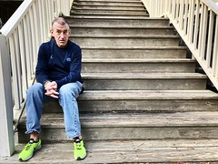 Sitting on th estairs (Oberazzi) Tags: portrait expression expressive seated stairs outdoors beach charleston follybeach green shoes jeans wood railings steps man south carolina tarheel unc