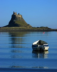 Reflecting on a quiet life (WISEBUYS21) Tags: lindisfarne castle boat sea reflection reflecting quiet life holy island northumberland ripples pont still water seascape seaside blue green hill sky seas northumbria northeastofengland alnwick coastal coast february day landscape st cuthbert viking rowing small fortress portrait shot