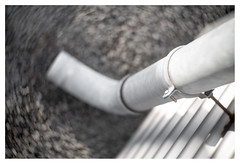 Going down (leo.roos) Tags: golfplaat corrugatediron drain afvoer pijp pipe swirly gammadekkershoek denhaag thehague projectionlens projectorlens hugomeyerkinoniiisuperiorf65cm a7rii darosa leoroos meyerkinon65mm meyerkinon65cm