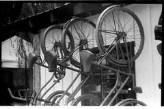 Bicycles_LeicaIIIISummarTriX_285 (Johnny Martyr) Tags: bicycles bicycle bike bikes circles wheels row three trio hanging vintage banana seat leica leitz barnack screw mount ltm knob wind thread summar nickel black i iii classic antique retro bw white kodak repeat repetition 3 mechanical flare