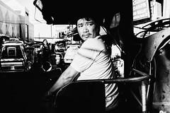Tricycle Driver (Meljoe San Diego) Tags: meljoesandiego fuji fujifilm x100f streetphotography street light candid monochrome philippines