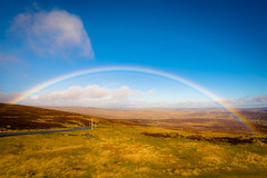 Over the rainbow (tonguedevil) Tags: landscape outdoor outside view countryside winter nature moorland hills hillside road car rainbow sky cloud colour light sunlight shadows bollihope weardale