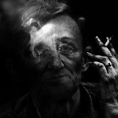 Smoke gets in your eyes (Ales Dusa) Tags: woman face cigarette smoker smoke blackandwhite streetportrait streetshot outdoor people bwportrait closeupportrait human humanity ring hand strongcontrast detailedportrait alesdusa canon canoneos5dmarkii ef70300mmf456lisusm candid eyes bw monochrome dramaticportrait strikingportrait storytelling character
