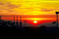 It is a new day in my world! (Fnikos) Tags: sky skyline cloud sea water mar seascape landscape dawn amanecer sun rays city architecture construction building chimenea chimney tree nature bird outdoor