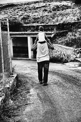 Grandfather and grandson (Mario Ottaviani Photography) Tags: sony sonyalpha italy italia scenic exploration view vista breathtaking tranquil tranquility serene serenity calm marioottaviani viaggio avventura natura esplorazione capestrano abruzzo exploring black white blackandwhite monochrome monocromo grandfather grandson nonno nipote family generation
