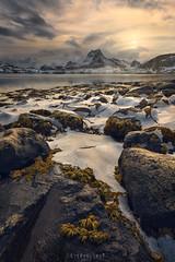 Crust crush (Ron Jansen - EyeSeeLight Photography) Tags: lofoten norway winter north arctic cold ice sunset glow light sun rocks depth mountains sea seaweed weed green clouds