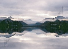 Reflections (double exposure), Derwentwater, February 2016 (Mano Green) Tags: lake district england cumbria water mountain hill tree sky cloud reflection winter february 2016 double exposure 35mm film kodak gold 200 canon eos 300 70300mm lens derwentwater