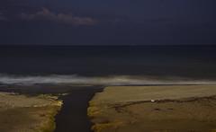 (Cindy en Israel) Tags: mar costa playa desembocadura agua cielo nubes estrella efectoseda mediterráneo olas noche nocturna arena orilla paisaje marina