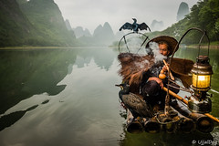 Cormorant Fisherman @Yangshuo (ujjal dey) Tags: ujjal ujjaldey guilin yangshuo china travel traveler fishermen cormorant landscape mountain river reflection dailylife evening fall dusk krast fujifilm xe2s