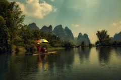 Rafting on Li River (Sunset Dogs) Tags: