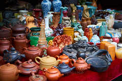 Marketplace07 (ArdieBeaPhotography) Tags: local market vendors consumers shopping customers browsing goods produce stalls vase teapots trinkets inkstone seals statuette figurine buddha ceramic china stone clay glass marble glazed unglazed street tamronspaf2875mmf28xrdildasphericalif teapot