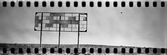 Interstate Billboard (No Stone Unturned Photography) Tags: roadside sign blackandwhite monochrome kodak folding expired ilford delta 100 35mm film sprocket holes jiffy camera art deco 1933 six16 616 panoramic