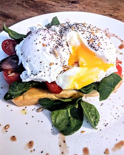 Poached eggs on sourdough, everyone loves that, yes? Well @thegaragencl do them just about perfectly, with generously buttered toast and fresh baby spinach. Cool little cafe in an old garage, go check them out :-)