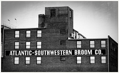 Atlantic Southwestern Broom Company (Rex Block) Tags: atlanticsouthwesternbroomcompany nikon d750 dslr 85mm f18g baltimore camden camdencrossing bostonstreet brick building industrial warehouse banner sign atlantic broom monochrome bw 2019fave maryland