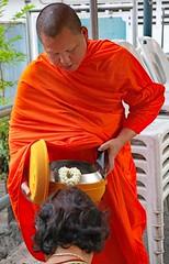 Buddhist Monk gathering alms. (grab a pic) Tags: canoneos5dmarkiv canon eos 5d thailand bangkok 2019 monk male thai tradition buddhism buddhists theravada buddhistsmonk alms bowl woman prayer