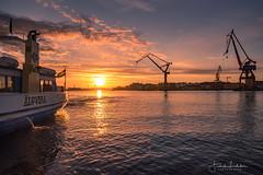 Event Horizon (Fredrik Lindedal) Tags: ferry sunset water harbor cranes sky skyline colors colorful reflection clouds horizon gothenburg göteborg göteborgshamn götaälv goldentime sweden sverige lindedal