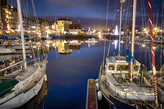 "all lit up, yachts and La Lieutenance reflected in waters of the Vieux Bassin (Old Harbour), Honfleur, Calvados, Normandie, France (grumpybaldprof) Tags: ""vieuxbassin"" ""oldharbour"" honfleur calvados normandie normandy france quai ""stecatherine"" ""lalieutenance"" quarantaine water boats sails ships harbour historic monument picturesque restaurants bars town port colour lights reflection architecture buildings mooring sailing stone yachts carousel merrygoround reflections ""waterreflections ""wetreflections"" funfair yacht voillier waterfront ""longexposure"" dark night nocturne nighttime ""lowlight"" striking artistic interpretation impressionist stylistic style contrast shadow bright black white illuminated mood moody atmosphere atmospheric canon 70d ""canon70d"" sigma 1020 1020mm f456 ""sigma1020mmf456dchsm"" ""wideangle"" ultrawide christmas refections"
