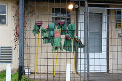 Mops on the Back Porch (Gene Ellison) Tags: old house cafe backporch cleaning mops security fence gate door fujifilm
