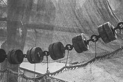 drying the nets (ro_ha_becker) Tags: leicastandardconvleicaii leitzelmar3550mm kodaktmax100 meinfilmlab film analogue monochrome schwarzweiss zwartwit biancoenero blancetnoir blackandwhite blancoynegro hafen harbour boot fishingboat boat greetsiel