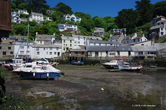 3KB06155a_C (Kernowfile) Tags: cornwall cornish pentax polperro water mud boat reflections rocks trees bushes hills slope sky bluesky cloud houses cottages pier cornishharbours