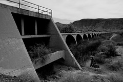 Gillespie Dam BnW_14 (Ed Cheremet) Tags: abandoned architecture arizona arlingtonarizona blackwhite buildings desertargonaughtgmailcom edcheremet family genre ghosttown gillespiebridge gillespiedam miningtown nature people subject town treatment arches doors httpedcheremetartistwebsitescom