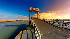 Carbridge In The Sun (Alfred Grupstra) Tags: sea beach coastline sky sunset water outdoors nature blue sand travel summer pier landscape bridgemanmadestructure dusk scenics famousplace vacations transportation carbridge