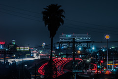 the nimitz freeway at 42nd avenue (pbo31) Tags: bayarea eastbay alamedacounty nikon d810 color night dark black rain wet storm boury pbo31 urban city march 2019 fruitvale district oakland skyline over lightstream motion traffic roadway 880 freeway silhouette infinity palm oracle arena gas station shell exit ramp red