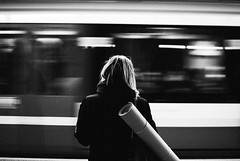 Meditate (ewitsoe) Tags: 35mm cityscape commute europe everyday nikon nikond80 street warszawa erikwitsoe erikwitsoecom life poland urban warsaw metro woman standing motion bnw blackandwhite monochrome mono train tram yogamat grain contrast