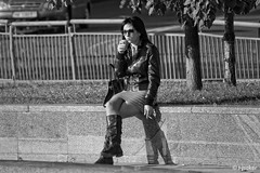 Girl with a Cigarette BW (t-maker) Tags: woman female ukrainian leather jacket glasses sunglasses miniskirt skirt leg legs knee knees highboot boot bag cigarette smoking coffee drink plastic cup shadow stone autumn fall car auto automobile vehicle fence fencing grass tree trunk stem bole rind bark leaf leaves rest relaxation recreation spontaneous emotional portrait pavement sidewalk square street streetphotograph streetphotography candid public place urban environment human activity social documentary city town hdr blackandwhite monochrome bnw noir noiretblanc kyiv kiev ukraine canon eos
