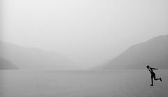 Smoke (Rick Exstrom) Tags: rickexstrom smoke landscape water person portrait jumping monochrome blackandwhite bwartaward