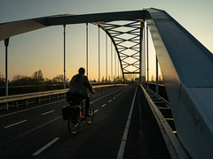 March Bicycle Commute 4 of 4 (beeldmark) Tags: silhouette fiets brug woonwerk zonsondergang zonnig weg latemiddag commute road sunny sunset bicycle bridge cycling earlyevening fietsen lateafternoon vroegeavond nieuwegein utrecht nederland nl beeldmark panasonic gm1