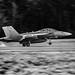 VAQ-129 VIKINGS' EA-18G GROWLER LEAVING TIRE SMOKE IN MONOCHROME