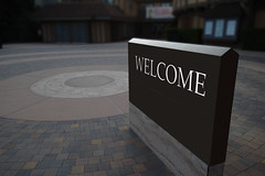 Welcme SIgn Oudoors (Jonatan Svensson Glad (Josve05a)) Tags: outdoors urban architecture stone building city road street brick concrete sign business outdoor gray tile old welcome sidewalk nobody asphalt pattern pavement welcomesign