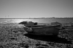 Boats at low tide (sam.naylor) Tags: uk hayling island sussex chichester britain sea seaside coast pentax dslr digital 28mm black white monochrome sun warm contrast
