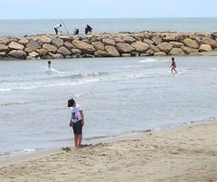 at the sea (derpunk) Tags: camargue provence saintesmariesdelamer kids children boy girl man men fishing water strand rock