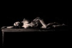Bronze body (Irena Rihova) Tags: body portrait bronze dark black backdrop vietnamese young beautiful beauty laying silhouette stunning restaurant
