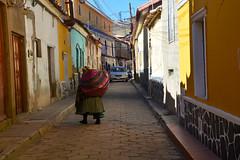 rue de Potosi Bolivie_2470 (ichauvel) Tags: femme woman marcher walking rue street façadescolorées maisons houses habitations voiture car étroit exterieur outside potosi altitude bolivie bolivia amériquedusud southamerica ameriquelatine jour day unesco unescoworldheritage oldcity getty