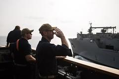 U.S. Navy Capt. Robert Bryans Jr., from Cohohes, New York, salutes to the dry cargo and ammunition ship USNS Charles Drew (T-AKE 10) (SurfaceWarriors) Tags: guidedmissilecruiser ussmobilebaycg53 ticonderogaclass usn csg3 arabiangulf us