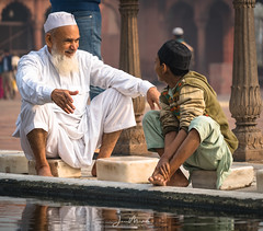 Bathing at the Mosque 2 (Wits End Photography) Tags: streetphotography mosque man male child delhi adult india reflection people street guy travelphotography washing places men drive pavement road roadway route