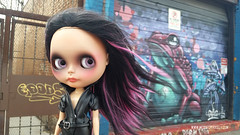 When you're walking down the street and suddenly your hair turns into a psychedelic frog. (Motor City Dolly) Tags: custom ooak blythe doll alpaca reroot hair purple black street art graffiti tan skin smoky eye sandra coe motor city dolly