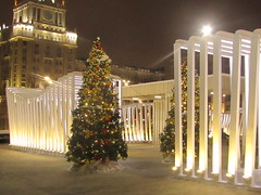 near Mayakovskaya station (VERUSHKA4) Tags: hccity canon europe russia moscow ville city cityscape evening night light lighting vue view outdoor square street tverskayastreet holiday christmas fence decoration building facade window fenetre clock townclock winter hiver january lamp firtree two