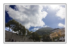 Clouds above the city (Audrey A Jackson) Tags: canon60d gibralter sky clouds rock buildings trees