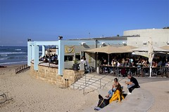Restaurant at Charles Clore Beach (oxfordblues84) Tags: israel telaviv telavivisrael herbertsamuelboardwalk building architecture bluesky blue sky people beach charlesclorebeach mediterraneansea water horizon man woman restaurant steps stairs sitting yaffo telavivyaffo