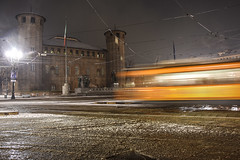 Il tram che ruppe il silenzio - The tram that broke the silence. (sinetempore) Tags: iltramcheruppeilsilenzio thetramthatbrokethesilence neve snow torino turin inverno winter tram piazzacastello piazzacastellotorino sera evening notte night lungaesposizione orangetram castello castle