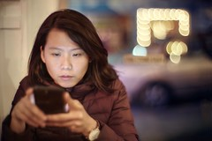 Absorbed in cyberspace (PeterThoeny) Tags: monterey california usa portrait woman mobilephone smartphone texting night indoors bokeh blur sony a7 a7ii a7mii alpha7mii ilce7m2 fullframe vintagelens dreamlens canon50mmf095 canon 1xp raw photomatix hdr qualityhdr qualityhdrphotography pacificgrove peppersmexicalicafe fav100