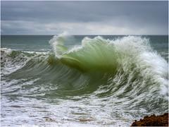 An incoming wave (Luc V. de Zeeuw) Tags: cloud clouds coast coastline ocean rock water wave lagoaecarvoeiro algarve portugal